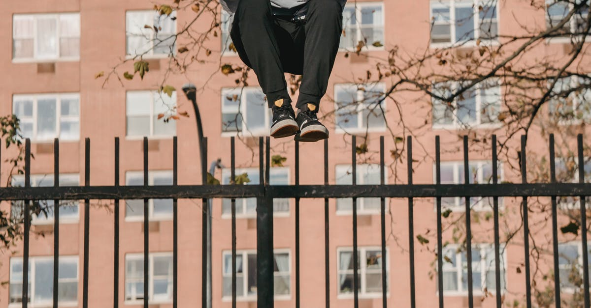 A person doing a trick in front of a building